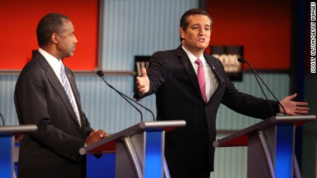Republican presidential candidate Ben Carson (L) looks on as U.S. Sen. Ted Cruz (R-TX) speaks during the Republican Presidential Debate sponsored by Fox Business and the Wall Street Journal at the Milwaukee Theatre on November 10, 2015 in Milwaukee, Wisconsin.