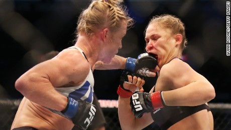 MELBOURNE, AUSTRALIA - NOVEMBER 15:  Ronda Rousey of the United States (R) and Holly Holm of the United States compete in their UFC women's bantamweight championship bout during the UFC 193 event at Etihad Stadium on November 15, 2015 in Melbourne, Australia.  (Photo by Quinn Rooney/Getty Images)