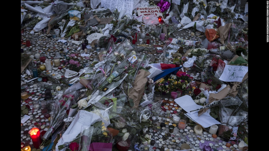 'A memorial commemorates the victims of the Paris attacks on a street in Paris on Monday, November 16.' from the web at 'http://i2.cdn.turner.com/cnnnext/dam/assets/151116202726-01-paris-aftermath-1116-super-169.jpg'