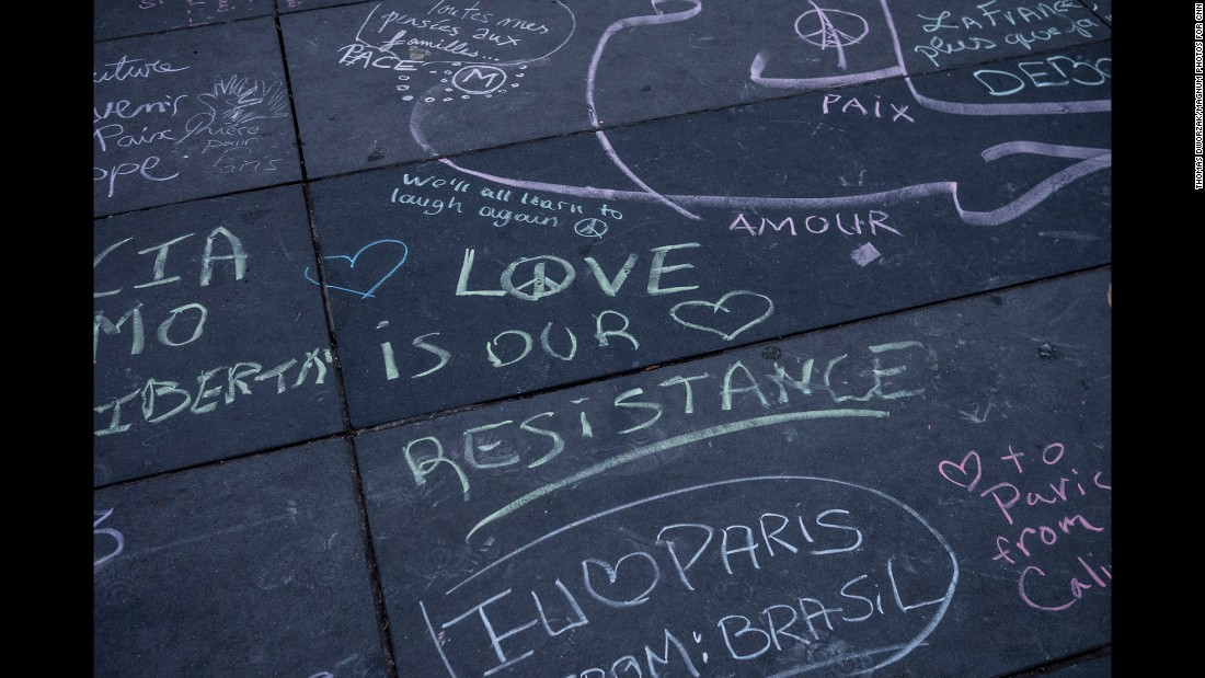 'Comments made with different colored chalk are written on the Place de la Republique in Paris on November 16.' from the web at 'http://i2.cdn.turner.com/cnnnext/dam/assets/151116211513-06-paris-aftermath-1116-super-169.jpg'