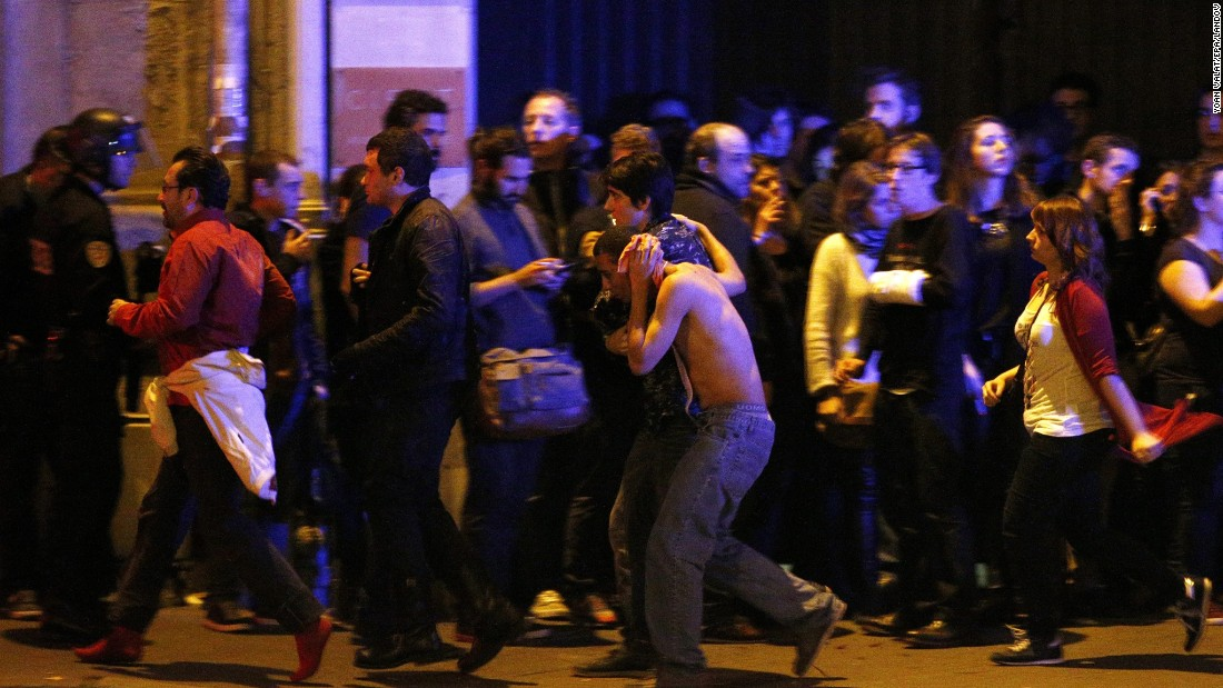 Wounded people are helped outside the Bataclan concert hall in Paris following a series of coordinated attacks in the city on Friday, November 13. The militant group ISIS claimed responsibility lt;a href=quot;http://www.cnn.com/2015/11/13/world/gallery/paris-attacks/index.htmlquot; target=quot;_blankquot;gt;for the attacks,lt;/agt; which killed at least 130 people and wounded hundreds more.