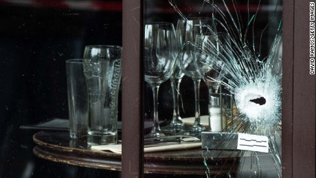 PARIS, FRANCE - NOVEMBER 14:  Bullet holes and marks are seen on the windows of the Cafe Bonne Biere restaurant on November 14, 2015 in Paris, France. At least 120 people have been killed and over 200 injured, 80 of which seriously, following a series of terrorist attacks in the French capital.  (Photo by David Ramos/Getty Images)