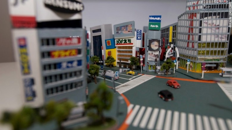 Japanese artist Inco Matsui creates mini cities using paper and glue.