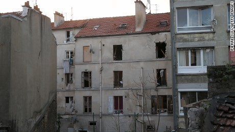 SAINT-DENIS, FRANCE - NOVEMBER 18:  The damaged building that was raided earlier in the morning is pictured on November 18, 2015 in Saint-Denis, France. French Police special forces raided an apartment, hunting those behind the attacks that claimed 129 lives in the French capital five days ago. At least one person was killed in an apartment targeted during the operation aimed at the suspected mastermind of the attacks, Belgian Abdelhamid Abaaoud. At least five police officers have been wounded in the shootout.  (Photo by Pierre Suu/Getty Images)