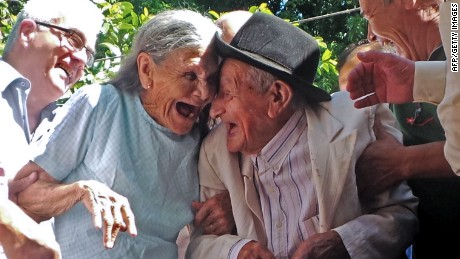 Paraguayan Anacleto Escobar (R), veteran of the Chaco War (1932-1935) fought between Paraguay and Bolivia, and his wife Cayetana Roman, smile during a ceremony coinciding with his 100th birthday in which they received a house -- the first in their lives they own -- as a gift for his merits, in Neembucu, Paraguay, on January 7, 2015. The event was organized by the governor of the state of Neembucu, Carlos Silva, to honour Escobar.   AFP PHOTO / STR  (Photo credit should read --/AFP/Getty Images)