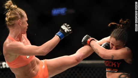 LOS ANGELES, CA - FEBRUARY 28:  (L) Holly Holm kicks Raquel Pennington in their women's bantamweight bout during the UFC 184 event at Staples Center on February 28, 2015 in Los Angeles, California.  (Photo by Harry How/Getty Images)