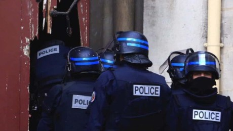 Two dead, eight arrested in Paris terror raid