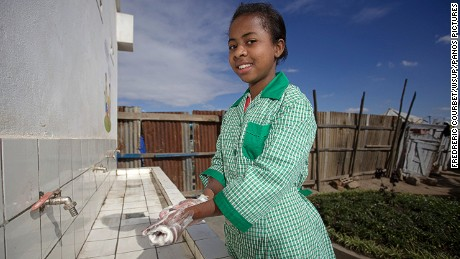"Erika, 14, uses the new toilets at her school in Antananarivo. She says: ""With these new toilets, I don't have to walk through dirty toilets with urine all over the floor. At home my younger brothers are constantly exposed to the risk of infections, which cause them to have diarrhoea and miss school"""