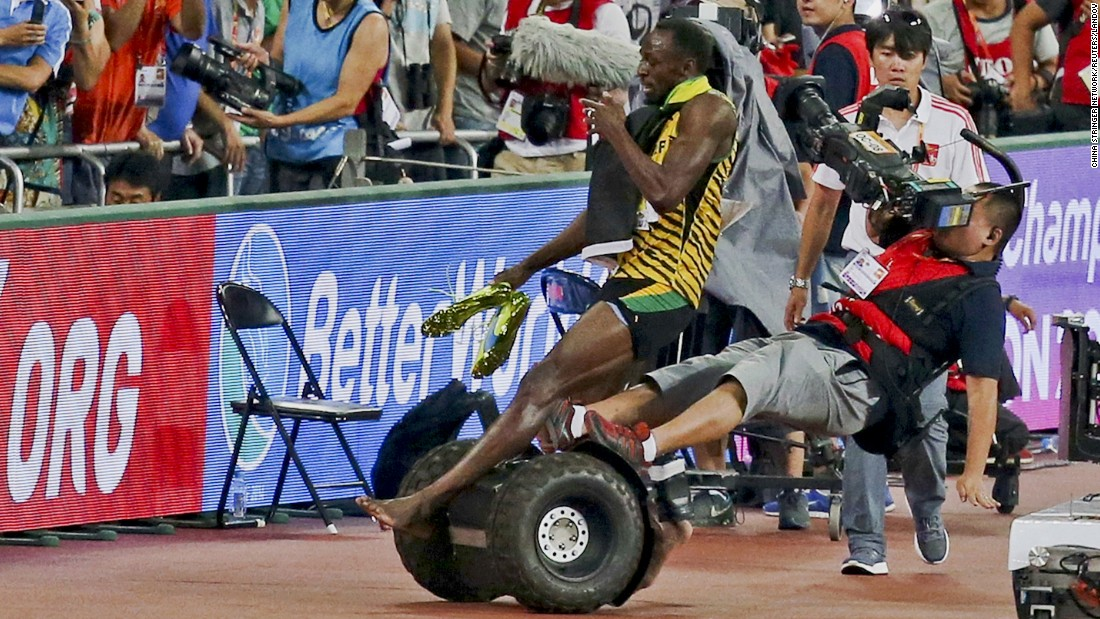 "After winning the 200-meter final <a href=""http://www.cnn.com/2015/08/30/sport/china-world-athletics-championships-wrap/"" target=""_blank"">at the World Championships</a> in Beijing, Jamaican sprinter Usain Bolt is accidentally knocked over by a cameraman on a Segway. Neither man was hurt, however, and they later <a href=""http://www.theguardian.com/sport/2015/aug/28/usain-bolt-segway-world-athletics-championships?CMP=share_btn_tw"" target=""_blank"">shook hands on the medal stand.</a>"