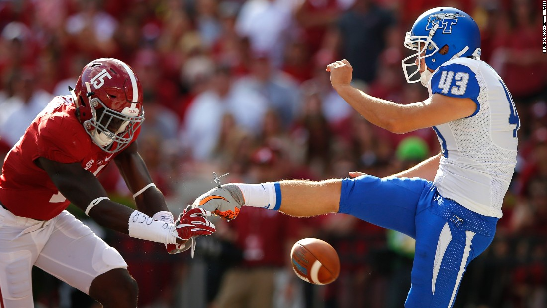 Alabama's Ronnie Harrison blocks a punt from Middle Tennessee's Trevor Owens during a college football game Saturday, September 12, in Tuscaloosa, Alabama.
