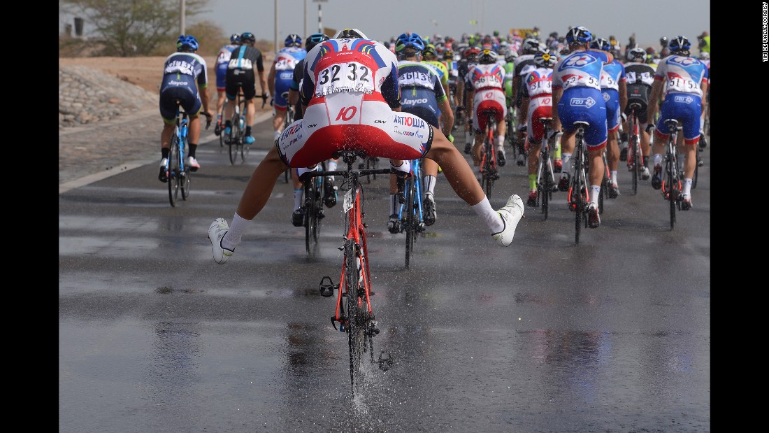 Italian cyclist Jacopo Guarnieri steers through a puddle Sunday, February 22, during the sixth stage of the Tour of Oman.