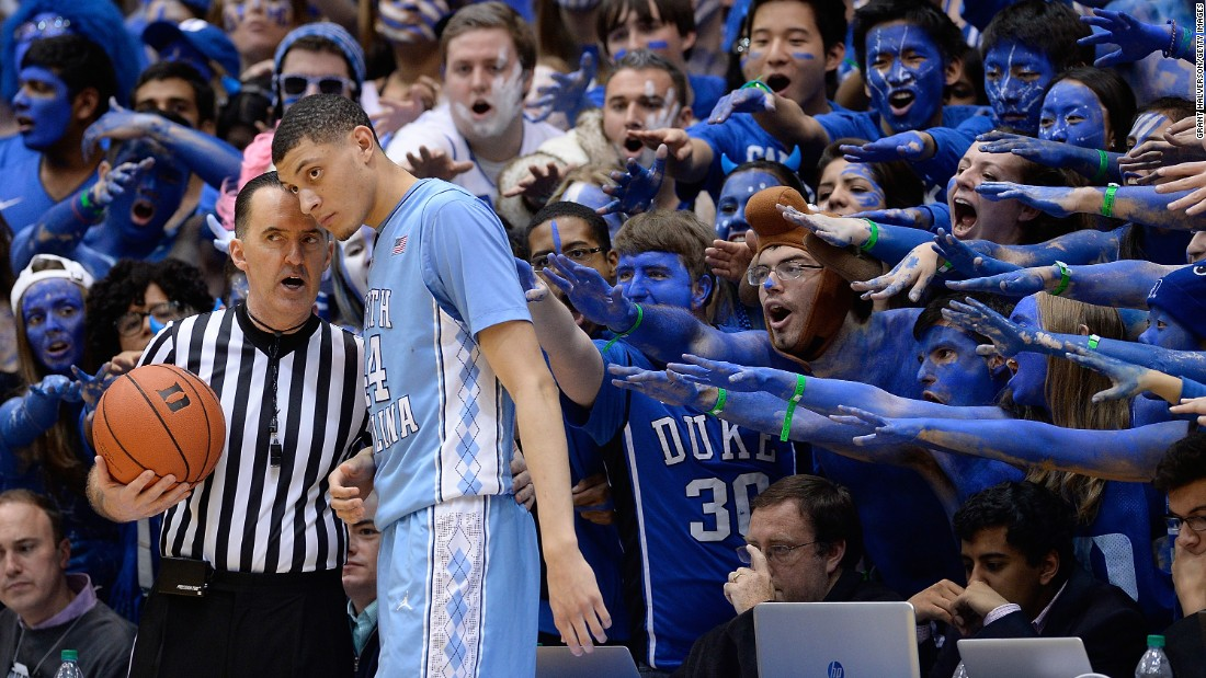 "Duke basketball fans -- the ""Cameron Crazies"" -- taunt North Carolina's Justin Jackson before an inbounds pass Wednesday, February 18, in Durham, North Carolina."