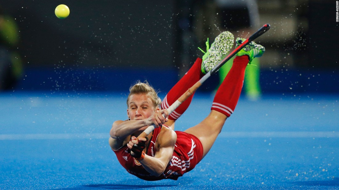 England's Alex Danson falls to the ground Wednesday, August 26, during a game against Germany at the EuroHockey Nations Championship. Danson had three goals in the 4-1 victory, and England -- the tournament hosts -- eventually won the tournament. Danson was named Player of the Tournament.