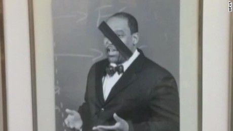 tape placed over black harvard professor portraits pkg _00002510.jpg