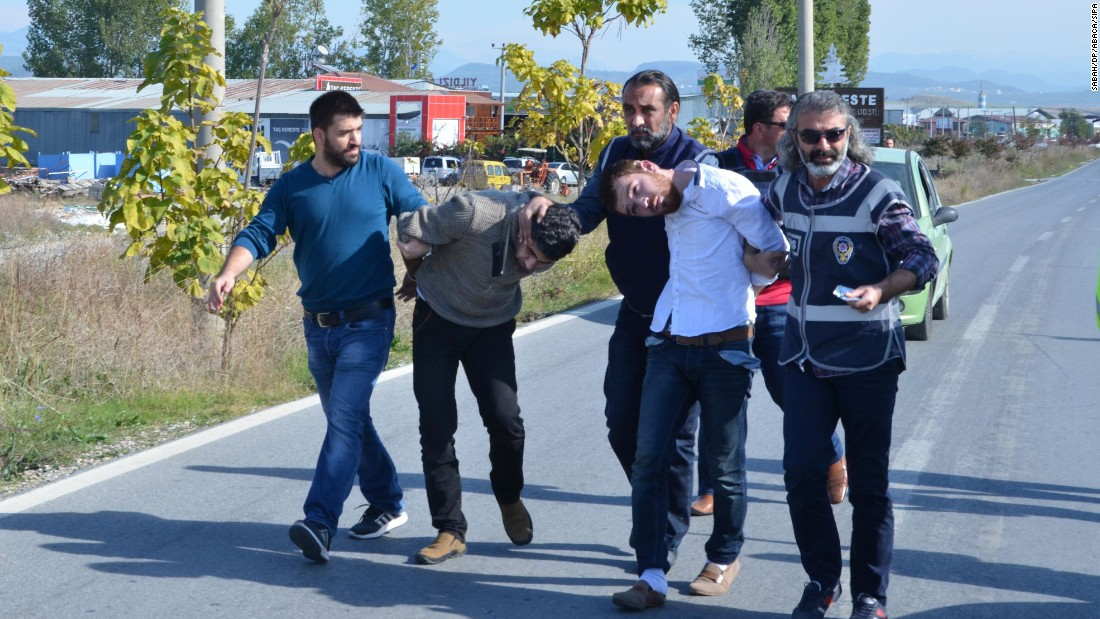 Two Syrian nationals, Ahmet Tahir, left, and Muhammed Verd, were arrested by Turkish security forces in southern Antalya province, Turkey, on November 20. They were captured, allegedly with a fake Syrian passport for Belgian national Ahmad Dahmani, suspected of location scouting for the Paris attackers.