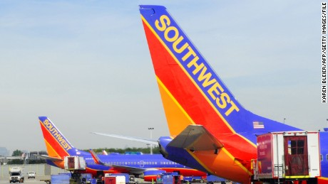 Southwest airlines planes on the tarmac at Chicago's Midway Airport in Chicago on Sepetmber 24, 2015. AFP PHOTO / KAREN BLEIER        (Photo credit should read KAREN BLEIER/AFP/Getty Images)