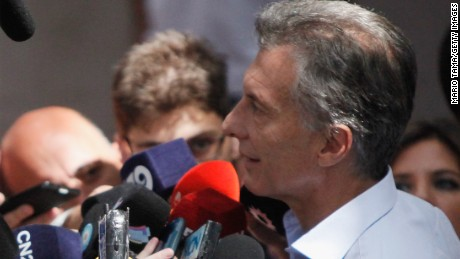 BUENOS AIRES, ARGENTINA - NOVEMBER 22:  Opposition presidential candidate Mauricio Macri speaks with the press after voting on November 22, 2015 in Buenos Aires, Argentina. Argentina is facing its first presidential election runoff in the history of the country on Sunday. Macri is squaring off against Daniel Scioli from the ruling party.  (Photo by Mario Tama/Getty Images,)
