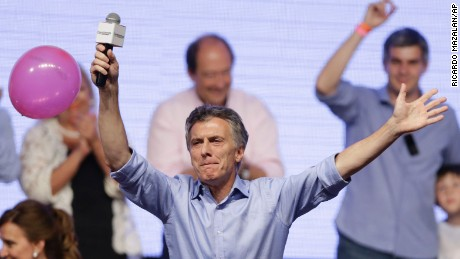 Opposition presidential candidate Mauricio Macri celebrates with supporters at his campaign headquarters in Buenos Aires, Argentina, Sunday, Nov. 22, 2015. Macri won Argentina's historic runoff election against ruling party candidate Daniel Scioli, putting an end to the era of  President Cristina Fernandez, who along with her late husband dominated Argentine politics for 12 years.  (AP Photo/Ricardo Mazalan)