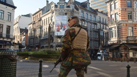 A Belgian Army soldier patrols in the Sablon District of Brussels on Monday, Nov. 23, 2015. The Belgian capital Brussels has entered its third day of lockdown, with schools and underground transport shut and more than 1,000 security personnel deployed across the country. (AP Photo/Virginia Mayo)