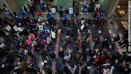 Holiday travelers line up for one of the TSA security checkpoints at Ronald Reagan National Airport (DCA) in Washington on November 26, 2013 as air traffic increases for  the Thanksgiving holiday.    AFP PHOTO/Paul J. Richards        (Photo credit should read PAUL J. RICHARDS/AFP/Getty Images)