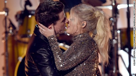 LOS ANGELES, CA - NOVEMBER 22:  Singers Charlie Puth (L) and Meghan Trainor kiss onstage during the 2015 American Music Awards at Microsoft Theater on November 22, 2015 in Los Angeles, California.  (Photo by Kevin Winter/Getty Images)