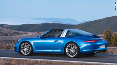 'Porsche is expanding its North American lineup with the debut of the Targa 4 and Targa 4S convertible. Both are all-wheel drive platforms and are equipped with the proven 3.0 Liter boxer style six-cylinder engines. The 2017 version of the 4S comes with rear wheel steering for enhanced handling at high speeds.' from the web at 'http://i2.cdn.turner.com/cnnnext/dam/assets/151123134109-la-auto-show-9-large-169.jpg'