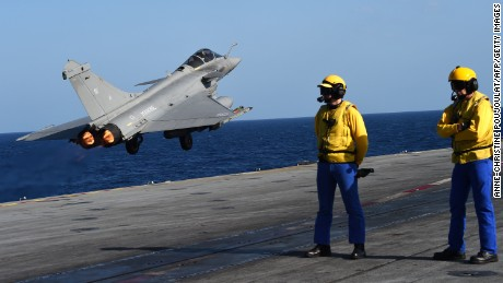 A French fighter jet takes off from the carrier Charles de Gaulle on Monday.
