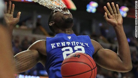 CHICAGO, IL - NOVEMBER 17:  Alex Poythress #22 of the Kentucky Wildcats gets his teeth caught in the net while dunknig against the Duke Blue Devils during the Champions Classic at the United Center on November 17, 2015 in Chicago, Illinois. Kentucky defeated Duke 74-63. (Photo by Jonathan Daniel/Getty Images)