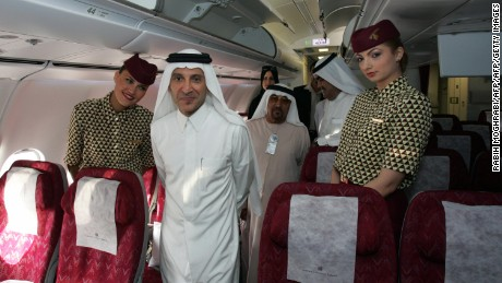 Dubai, UNITED ARAB EMIRATES:  Qatar Airways chief executive officer, Akbar al-Baker (C), tours with journalists the airline's brand new Airbus A340-600 aircraft at Dubai international airport 19 September 2006. Qatar Airways is the launch customer of the High Cross Weight version of the A340-600 which at 75 metres long, is the world's longest passenger jet. AFP PHOTO/RABIH MOGHRABI  (Photo credit should read RABIH MOGHRABI/AFP/Getty Images)