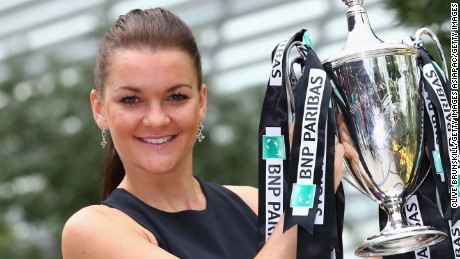 SINGAPORE - NOVEMBER 02:  Agnieszka Radwanska of Poland poses with the Billie Jean King Trophy at the Gardens by the Bay on November 2, 2015 in Singapore.  (Photo by Clive Brunskill/Getty Images)
