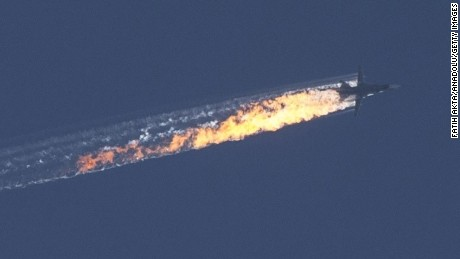 'Russian warplane goes down in Syria's northwestern town of Bayirbucak, near the Turkish border, on November 24, 2015.' from the web at 'http://i2.cdn.turner.com/cnnnext/dam/assets/151124093549-russia-jet-syria-crash-1-large-169.jpg'