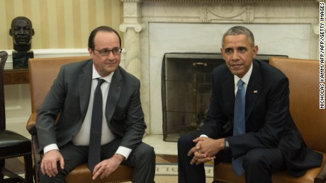 US President Barack Obama meets with his French counterpart Francois Hollande in the Oval Office at the White House in Washington, DC, on November 24, 2015. Hollande arrived Tuesday at the White House for talks with Obama on how to confront the Islamic State group in the wake of the Paris attacks. The French and US leaders were to hold a joint press conference following their meeting, part of a frantic week of shuttle diplomacy by Hollande to rally global support to fight IS.   AFP PHOTO/NICHOLAS KAMM / AFP / NICHOLAS KAMM        (Photo credit should read NICHOLAS KAMM/AFP/Getty Images)