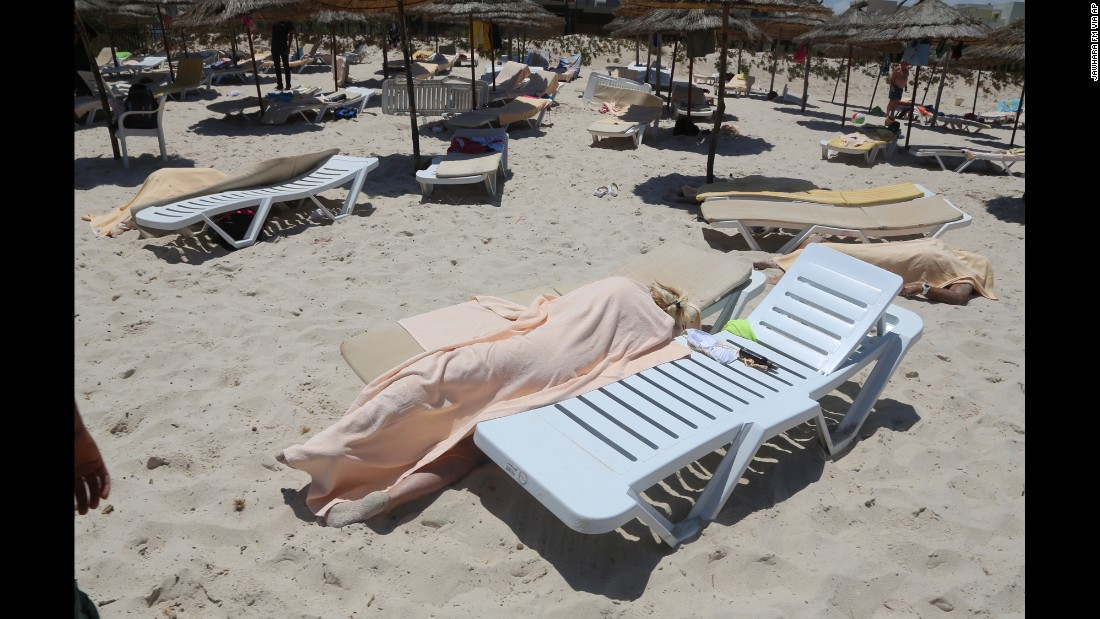 "<strong>June 26:</strong> Dead bodies lie near a beachside hotel in Sousse, Tunisia, <a href=""http://www.cnn.com/2015/06/26/world/gallery/tunisia-terrorist-attack/index.html"" target=""_blank"">after a gunman opened fire.</a> At least 38 people were killed in the terrorist attack."