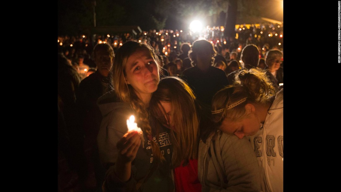 "<strong>October 1: </strong>Community members attend a candlelight vigil for those killed during <a href=""http://www.cnn.com/2015/10/01/us/gallery/oregon-shooting-umpqua-community-college/index.html"" target=""_blank"">a shooting at Umpqua Community College</a> in Roseburg, Oregon. The massacre left nine people dead. The gunman, Chris Harper-Mercer, apparently committed suicide after exchanging gunfire with officers, a sheriff said."