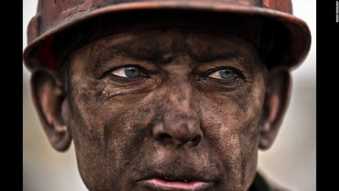 "<strong>March 4:</strong> A Ukrainian coal miner waits for a bus after exiting the Zasyadko mine, where he helped search for the bodies of his colleagues in Donetsk, Ukraine. Thirty-three workers were killed after <a href=""http://www.cnn.com/2015/03/04/europe/ukraine-miners-trapped/index.html"" target=""_blank"">an early morning explosion at the mine.</a>"