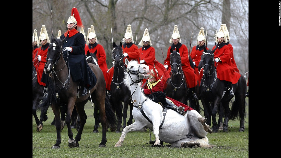<strong>March 26:</strong> A trumpeter falls off his horse as the Household Cavalry Mounted Regiment parades in London's Hyde Park. The British Army regiment was undergoing its annual inspection.