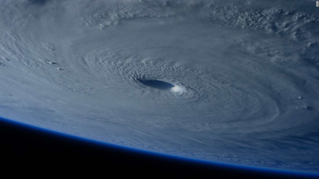 <strong>March 31:</strong> The eye of Super Typhoon Maysak is photographed from the International Space Station. The storm was churning over the Pacific Ocean, days away from making landfall in the Philippines.