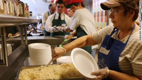 CAMDEN, NJ - OCTOBER 11:  Volunteers prepare meals at the Cathedral Kitchen soup kitchen which serves 300 to 600 meals a day, six days a week, to the needy and hungry on October 11, 2012 in Camden, New Jersey. Cathedral Kitchen was founded in 1976 and offers a variety of programs and life services to Camden's poor and disadvantaged. According to the U.S. Census Bureau, Camden, New Jersey is now the most impoverished city in the United States with nearly 32,000 of Camden's residents living below the poverty line. Camden, which sits just over the bridge from more affluent Philadelphia, also has a chronic crime problem with 48 recorded homicides this year alone. A lack of jobs has been a feature of life in Camden since the city lost most of its manufacturing base in the late 60's and 1970's. While the state unemployment rate is about 9.9 percent, Camden's is estimated at 19 percent.  (Photo by Spencer Platt/Getty Images)