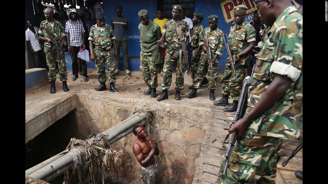 "<strong>May 7:</strong> Jean Claude Niyonzima <a href=""http://www.cnn.com/2015/05/07/africa/gallery/captured-in-burundi/index.html"" target=""_blank"">pleads with soldiers to protect him from a mob</a> after he came out of hiding in a sewer in Bujumbura, Burundi. Niyonzima was a suspected member of the ruling party's Imbonerakure youth militia. <a href=""http://www.cnn.com/2015/05/14/world/gallery/burundi-unrest/index.html"" target=""_blank"">Animosity against President Pierre Nkurunziza</a> boiled over in April when he expressed his intention to run for a third term. There were protests and a failed coup attempt. Nkurunziza <a href=""http://www.cnn.com/2015/07/24/africa/burundi-elections/"" target=""_blank"">was re-elected</a> in July."