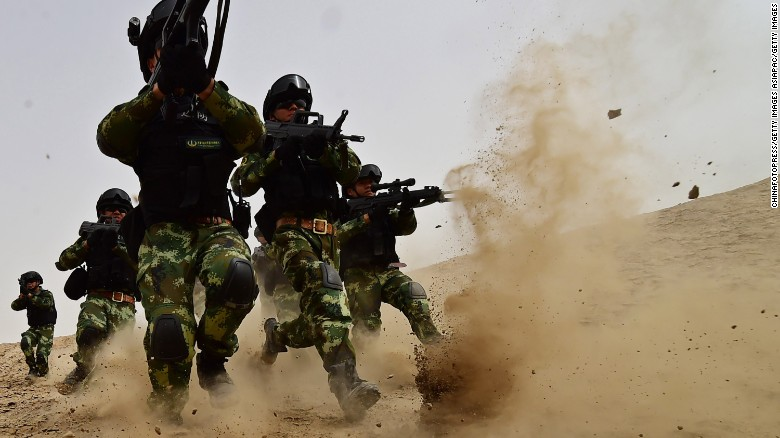 Soldiers of Xinjiang Armed Police Frontier Corps get drill in gobi desert of Yecheng County on August 17, 2015 in Kashgar, Xinjiang.