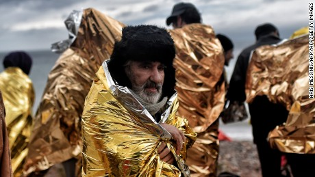 Refugees and migrants arrives on the Greek Island of Lesbos  on October 22, 2015 after crossing the Aegean sea from Turkey. An EU scheme to relocate asylum seekers from overstretched Italy and Greece could grind to a halt just two weeks after it began if member states fail to meet their obligations, an EU source said. AFP PHOTO / ARIS MESSINIS        (Photo credit should read ARIS MESSINIS/AFP/Getty Images)