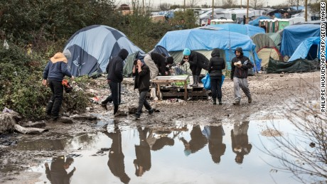 "Inhabitants of the migrant camp known as the ""Jungle"" near the northern French port of Calais."