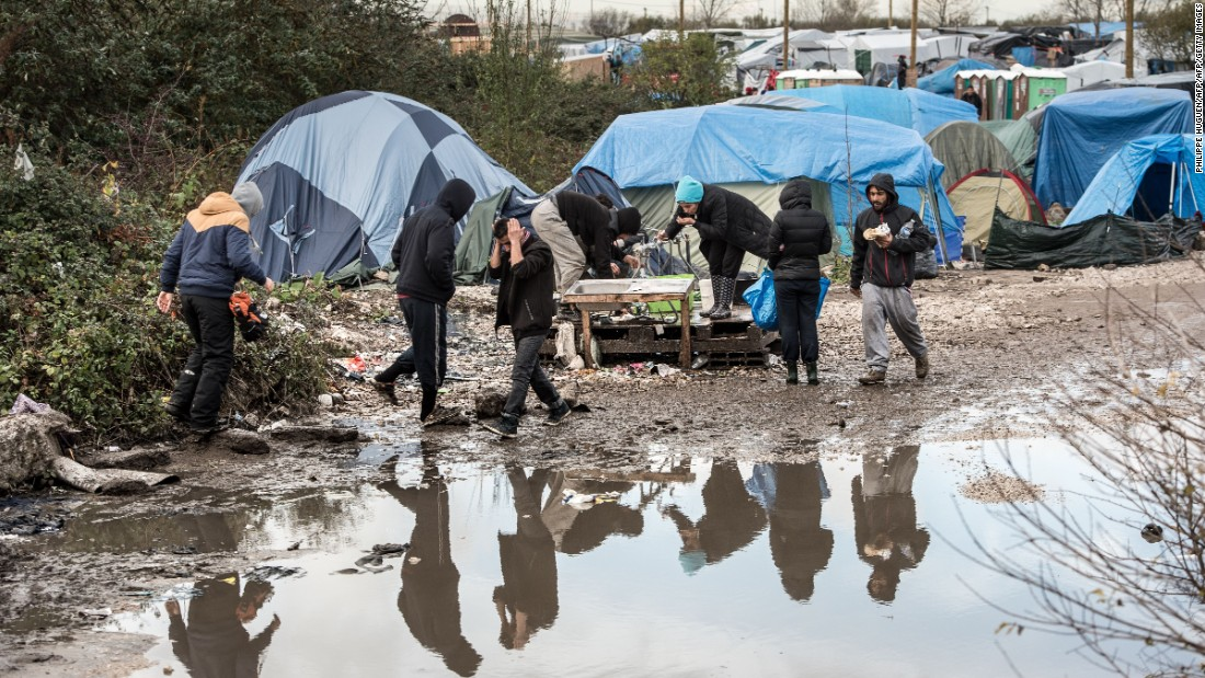 "Migrants and refugees in the migrant camp known as the ""Jungle"" near the northern French port of Calais where some 4,500 people live."