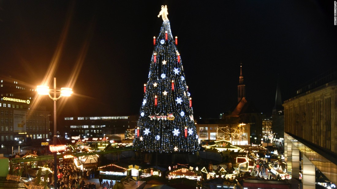 Germany's biggest Christmas tree is illuminated with 48,000 lights at the traditional holiday market in Dortmund, Germany. The 45-meter (148-foot) tree was built using 1,700 smaller trees.