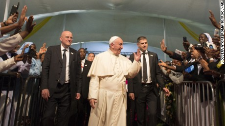 Pope Francis arrives for a meeting with clergy, religious men and women and seminarians at the sports field of St Mary's School, in Nairobi, Kenya, Thursday, Nov. 26, 2015. Pope Francis is in Africa for a six-day visit that is taking him to Kenya, Uganda and the Central African Republic. (L'Osservatore Romano/Pool Photo via AP)