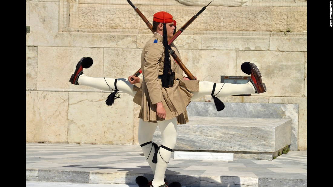 <strong>April 7:</strong> Honor guards march in front of the Tomb of the Unknown Soldier outside Greece's Parliament in Athens.