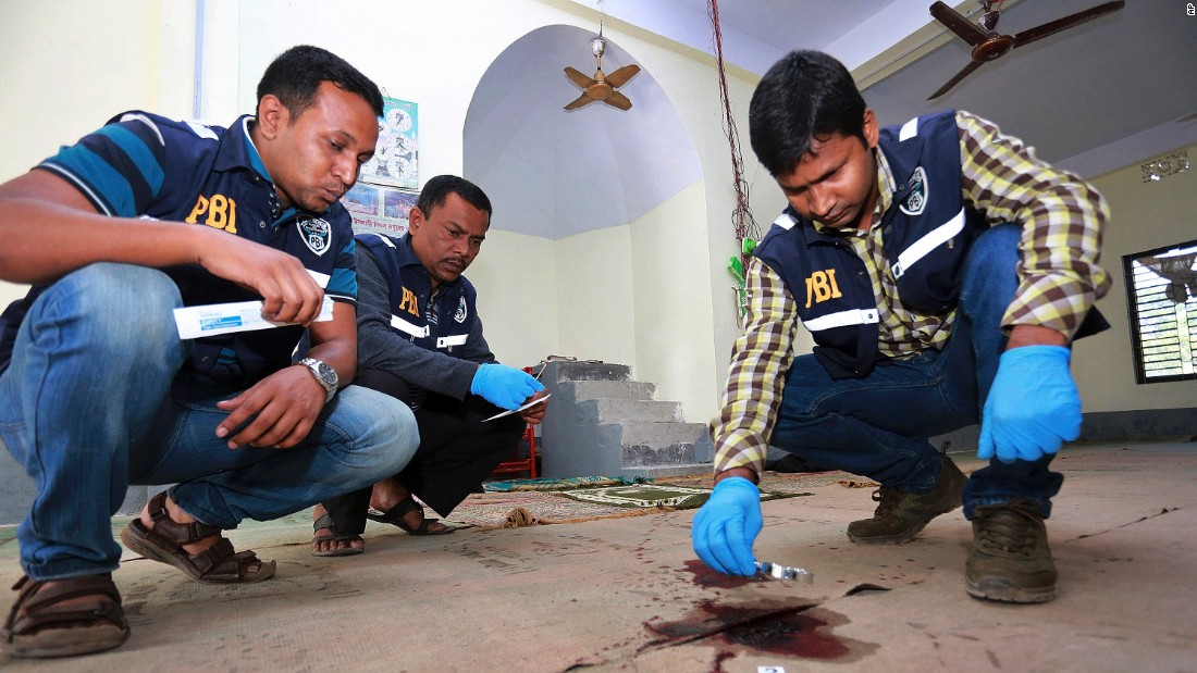 Investigators check the scene of a mosque attack Friday, November 27, in northern Bangladeshs Bogra district. lt;a href=quot;http://www.cnn.com/2015/11/27/asia/bangladesh-isis-attack-claim/index.htmlquot; target=quot;_blankquot;gt;ISIS has claimed responsibility for the attacklt;/agt; that left at least one person dead and three more wounded.