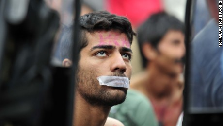 A man tapes his mouth shut in protest, right after getting told to reverse inside Gevgelija, Macedonia