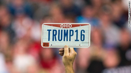 """COLUMBUS, OH - NOVEMBER 23:  A supporter holds up a personalized license plate labeled """"Trump16"""" during a campaign rally for Republican presidential candidate Donald Trump at the Greater Columbus Convention Center on November 23, 2015 in Columbus, Ohio. Trump spoke about immigration and Obamacare, among other topics, to around 14,000 supporters at the event.  (Photo by Ty Wright/Getty Images)"""