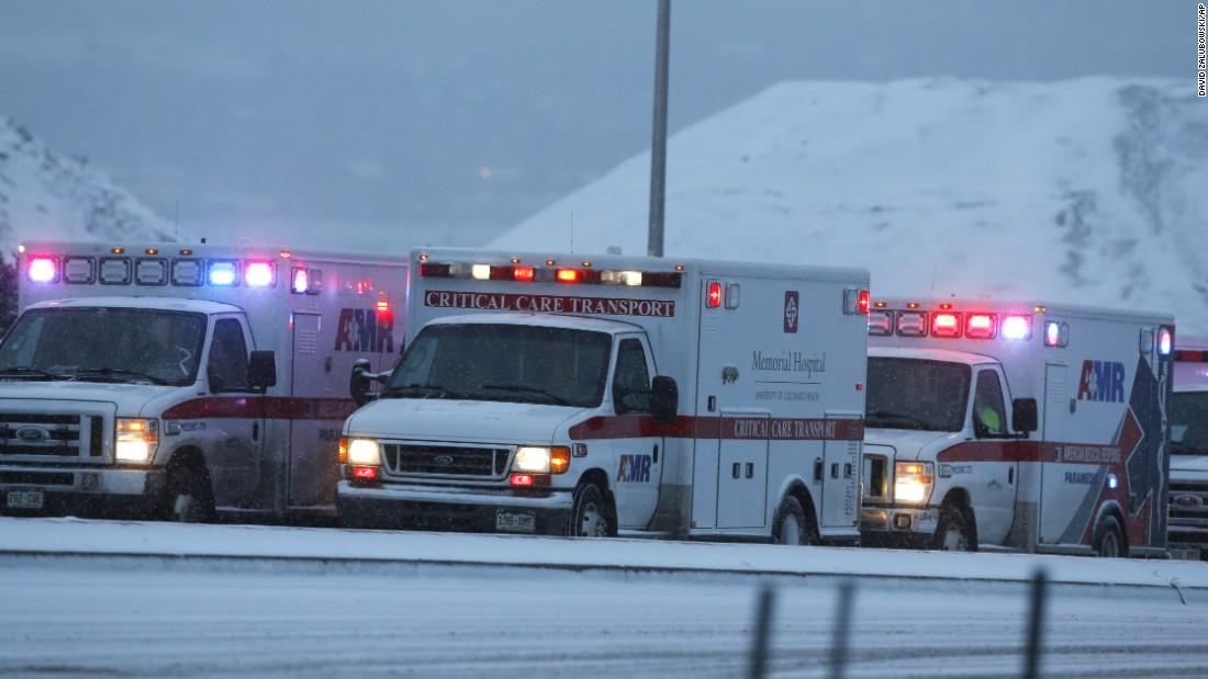 Ambulances wait to be directed near the scene.